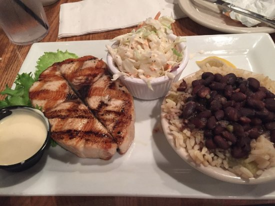 Schooners Restaurant : wahoo with cold slaw and rice and beans. Wow delicious