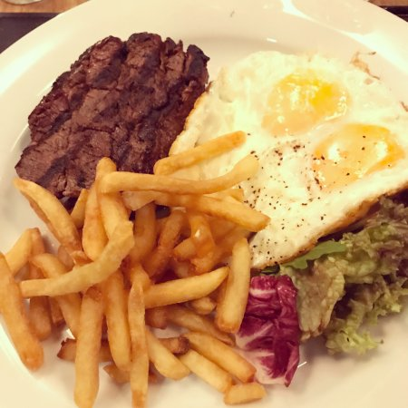 Walton-On-Thames, UK: Fillet steak, fried eggs and fries.