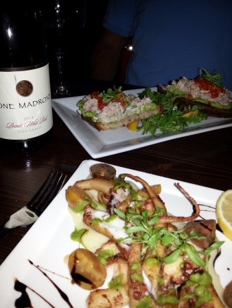 La Cosecha Bar + Restaurant: Our appetizers - grilled octopus and crab on toast.