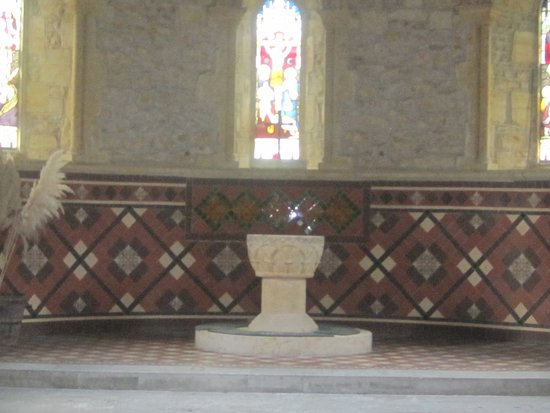 Dorset, UK: The font and leaded window above.