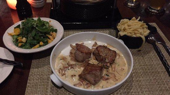 Brauhaus: Pork medallions with onion gravy, spatzle and lamb salad.