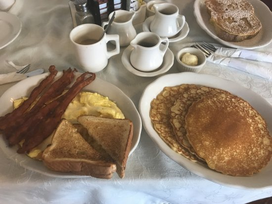 Royal Treat: Pancakes, eggs, bacon, toast, coffee