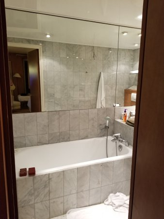"""Best Western Hotel Ronceray Opera: That hand held """"shower head"""" beside the tap is what passed for the shower. No curtain or enclosu"""