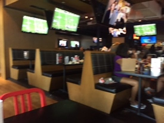 Decatur, GA: View of the many flat screen tvs available for patrons