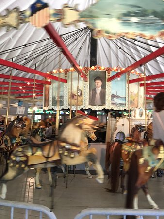 Pawtucket, RI: Looff carousel moving really fast!!