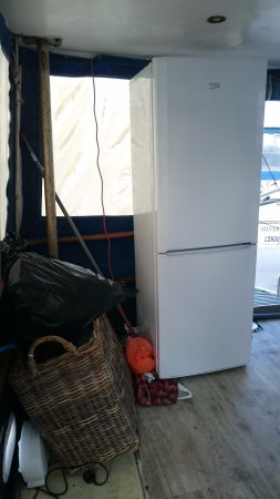 Con Dios: A fridge and other junk on the deck.