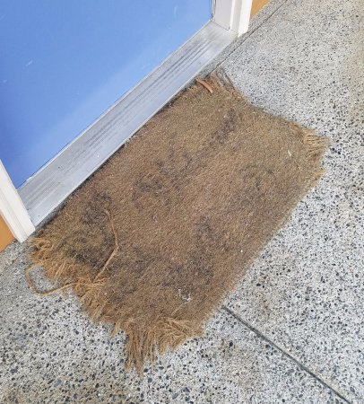 Motel 6 Gold Beach: Mat outside room that is literally falling apart and tripped me