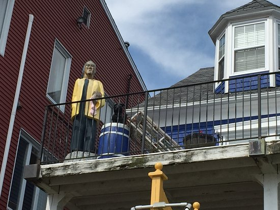 Lunenburg, Canada: Fisherman's wooden statue on the balcony across the street from the Fisheries Museum of the Atla