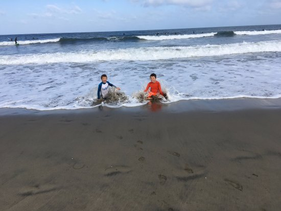 Pacifica, CA: My boys playing on the beach.
