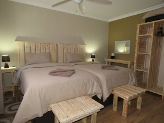 North-West District, Botswana: Oversized twin beds en suite in all  Chalets