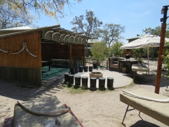 North-West District, Botswana: Enjoy communal evening meals around the fire-pit in the Boma