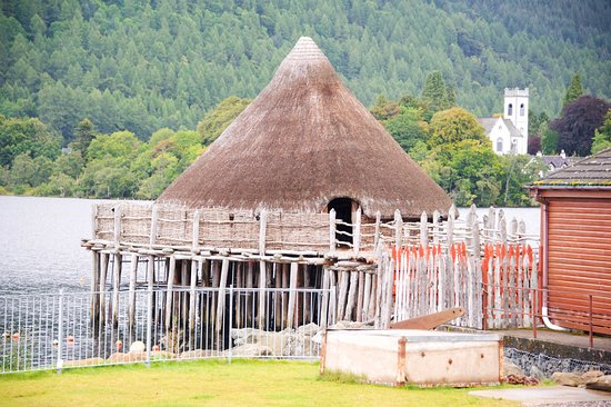 The Scottish Crannog Centre : Crannog (3,000 years old) and in the background a Norman tower (1,000 years old)