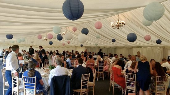 Weston under Wetherley, UK: The marquee is a perfect setting for the wedding breakfast