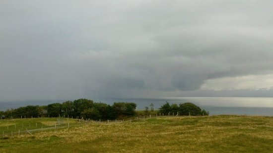 Staffin, UK: Rain clouds rolling in over Raasay