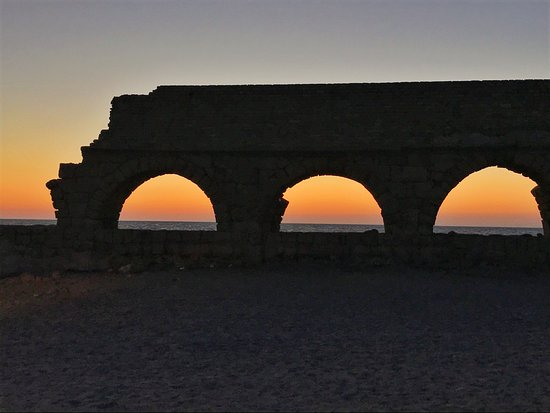 Caesarea, Israel: Roman Aqueduct with sunset on background
