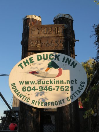 Duck Inn: Sign by the river