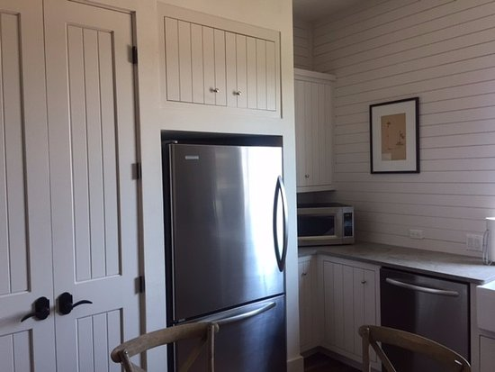 Hunt, TX: in kitchen, view of fridge, microwave, and dishwasher.