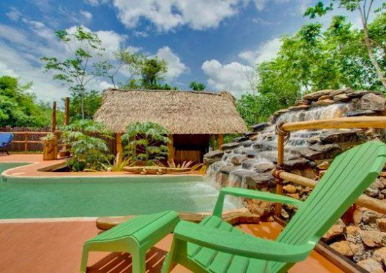 Mariposa Jungle Lodge: Fed by a slate waterfall, our L-shaped pool is refreshing after a day of adventures
