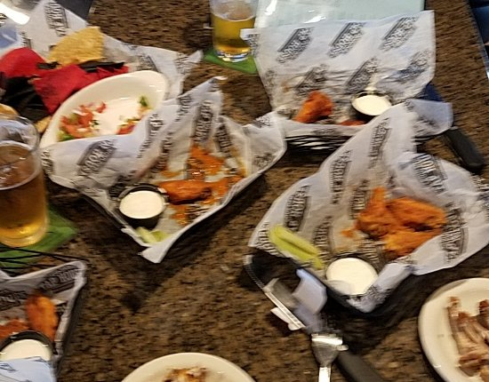 Alexandria, MN: Blurry picture of the multiple wing flavors we got.