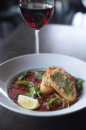 Lawrence, KS: Start off with the beef carpaccio.  Pairs great with one of our reds!