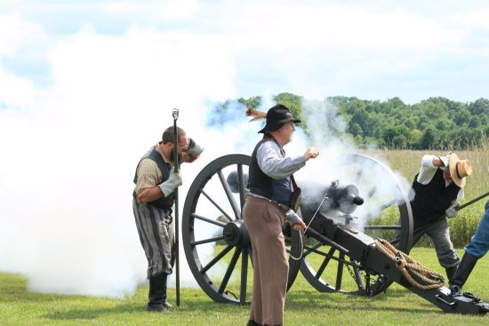 Pleasanton, KS: Reeinactors demonstrate how to use a historic canon at the 2017 Heritage Day celebration.