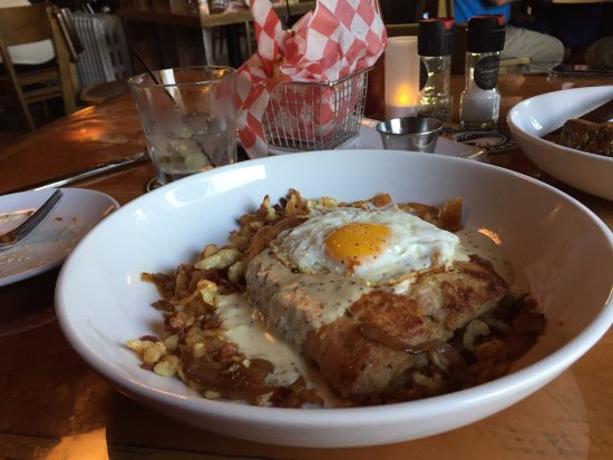 West Bend, WI: Pork Schnitel with fried egg and spaetzle.