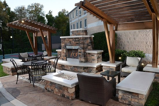 Morrisville, NC: Our outside fireplace is the perfect place to unwind after work.