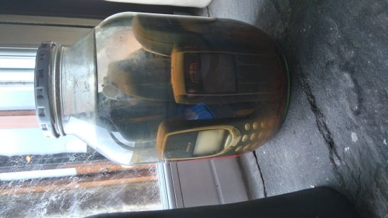 Low Row, UK: Mobile phones in a jar