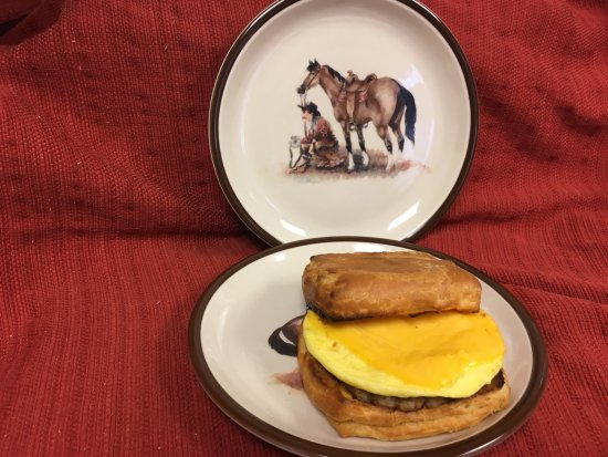 Brew Grit Coffee: Chuckwagon Croissant Breakfast Sandwich shown with sausage, egg and American cheese