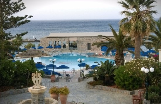 Nana Beach Hotel: Early evening view from Panorama Bar to main pool and Asian/Italian restaurants