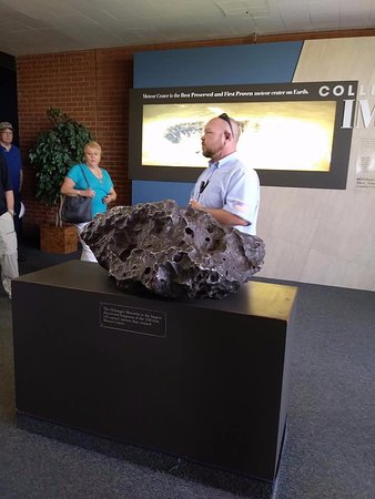 Winslow, AZ: One of the presenters explaining the crater, with a chunk of it in front of him.