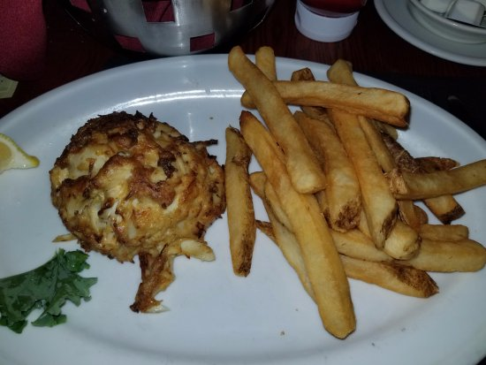 G & M Restaurant & Lounge: An 8 ounce crabcake and crispy fries!