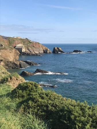 The Lizard point and the old lifeboat station from 1914 ( the third station ) in Polpeor Cove