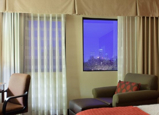 Holiday Inn Boston Brookline: Cozy King Executive Bed Guest Room with modern flat-screen HDTV.