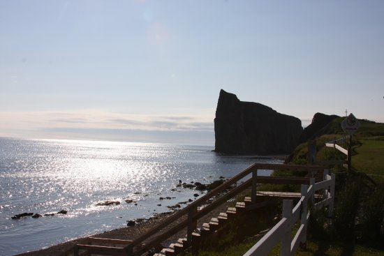 Pierced Rock (Rocher-Percé): Sunrise.  Stairs down to the beach.  Looked like people were clamming that day.