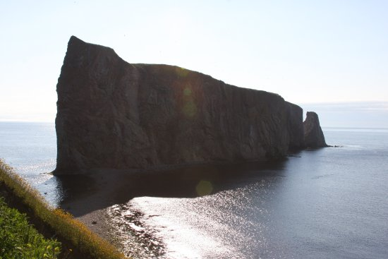 Pierced Rock (Rocher-Percé): Sunrise.  A beach goes out to the rock.