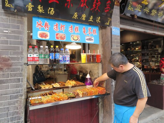 Chongqing, China: A stall selling local snacks