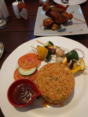 Johor Bahru District, Malaysia: Vegetarian Fried rice with Paprika lamb skewer in background