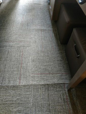Richmond Hill, GA: Shows almost every carpet quare buckled at seam
