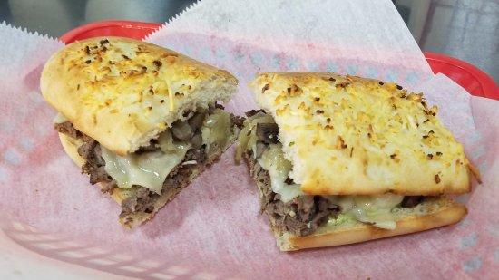 Royal Oak, Μίσιγκαν: Steakhouse with Marinated Steak, Portabellas, Carmelized Onions, 'WICH Sauce on ParmesanGarlic B