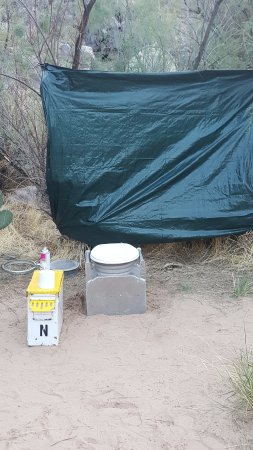 """Colorado River: Outdoor """"facilities""""- yes, the gray thing on the ground is the toilet!"""