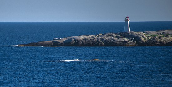 Peggy's Cove Lighthouse seen from the ocean.