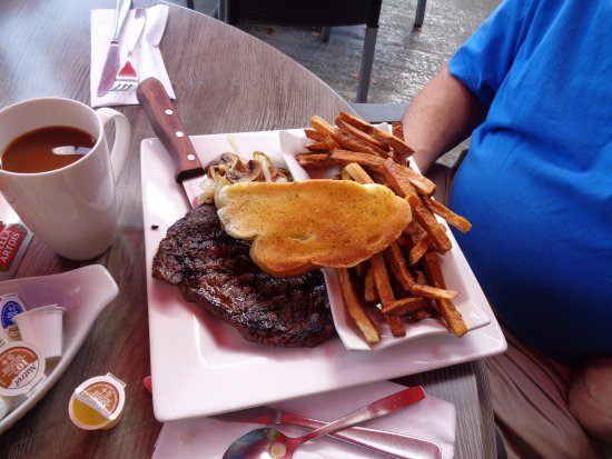 River Pub: Rib eye steak and fries.