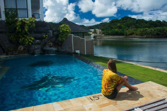 Colonia, Micronesia: Rike Rg relaxes by the Manta Ray Bay Resort pool in her Tim Rock Ocean Dreams Pacific shirts.