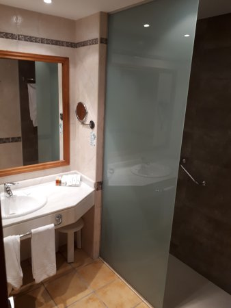 Walk in large shower. Provided lotions/kits that are complimentary ...