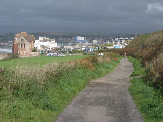 The path approaches Westward Ho! on the route of the former railway, Seafield House is in the le