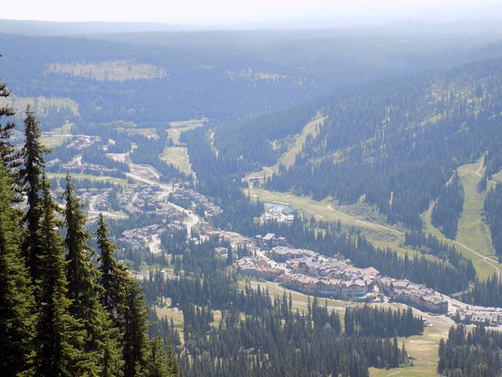Sun Peaks, Canada: chairlift ride looking into the village and surrounding hills.