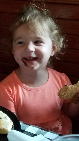 Crestview, FL: One of our little customers enjoying her Chocolate Chip Pancakes!