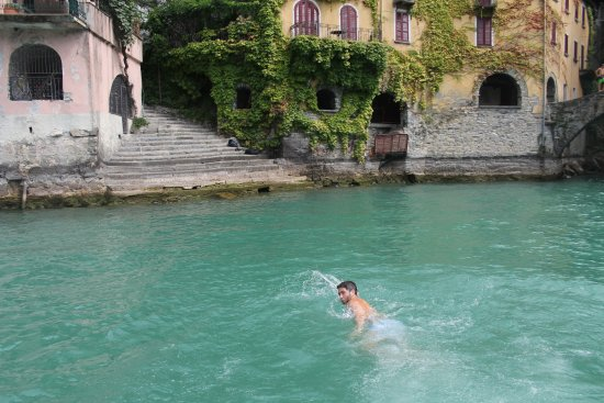 AC Boat: swimming in turqouise waters at nesso waterfall