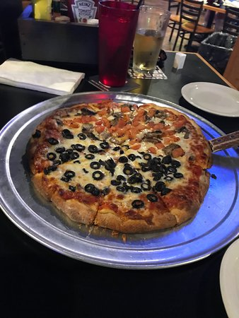 Sussex, WI: Small (supposed to be a Large) Pizza, half black olive and half tomato and mushroom